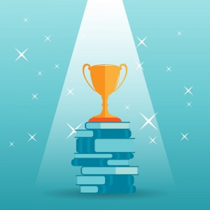 Vector illustration of a golden trophy on top of a stack of books.